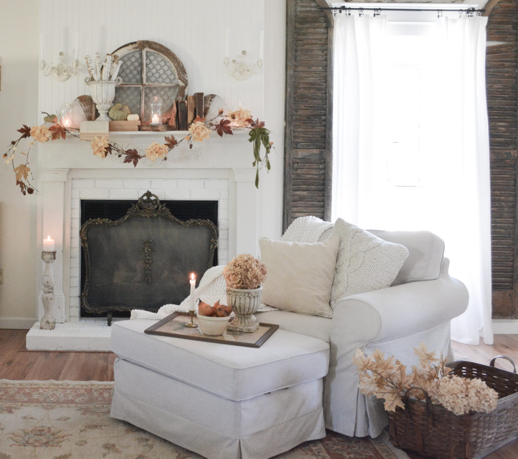 A cottage living room with a DIY fall garland